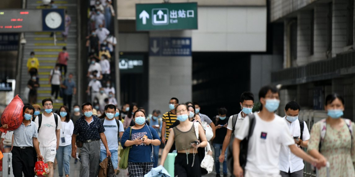 China to impose virus testing on Lunar New Year travelers, cases rising