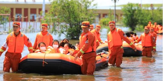 China raises emergency response level for flood control