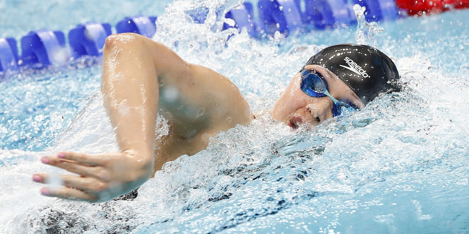 Haughey cruises through to 100m freestyle final in record time